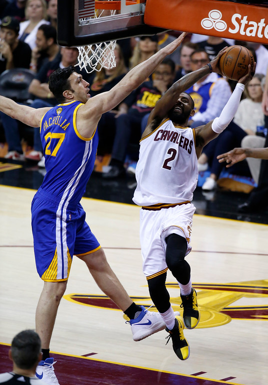 . Cleveland Cavaliers guard Kyrie Irving (2) drives on Golden State Warriors center Zaza Pachulia (27) during the first half of Game 3 of basketball\'s NBA Finals in Cleveland, Wednesday, June 7, 2017. (AP Photo/Ron Schwane)
