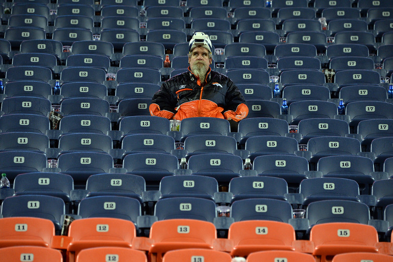 . Carter Cash of Sania Park, NM sits in the stands after the Broncos lost to the Colts 24 to 13.  The Denver Broncos played the Indianapolis Colts in an AFC divisional playoff game at Sports Authority Field at Mile High in Denver on January 11, 2015. (Photo by Craig F. Walker/The Denver Post)