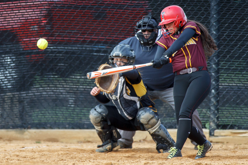 Sheehan's Missy Pereira (19) makes contact with a pitch from Amity's Katie Koshes (2) for a base hit Thursday at Amity Regional High School in Woodbridge Apr. 23, 2015 | Justin Weekes / For the Record-Journal