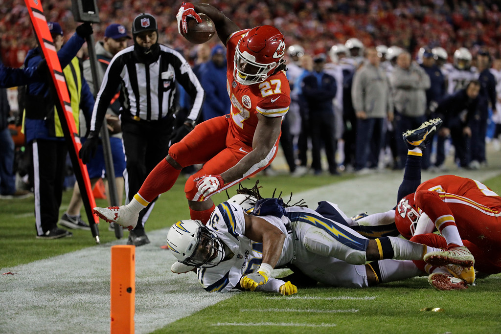 . Los Angeles Chargers safety Adrian Phillips (31) tackles Kansas City Chiefs running back Kareem Hunt (27) during the second half of an NFL football game in Kansas City, Mo., Saturday, Dec. 16, 2017. (AP Photo/Charlie Riedel)