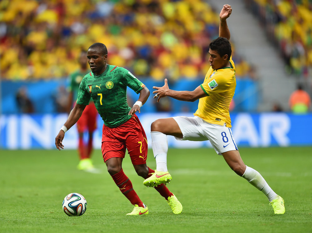 . Landry N\'Guemo of Cameroon controls the ball against Paulinho of Brazil during the 2014 FIFA World Cup Brazil Group A match between Cameroon and Brazil at Estadio Nacional on June 23, 2014 in Brasilia, Brazil.  (Photo by Buda Mendes/Getty Images)