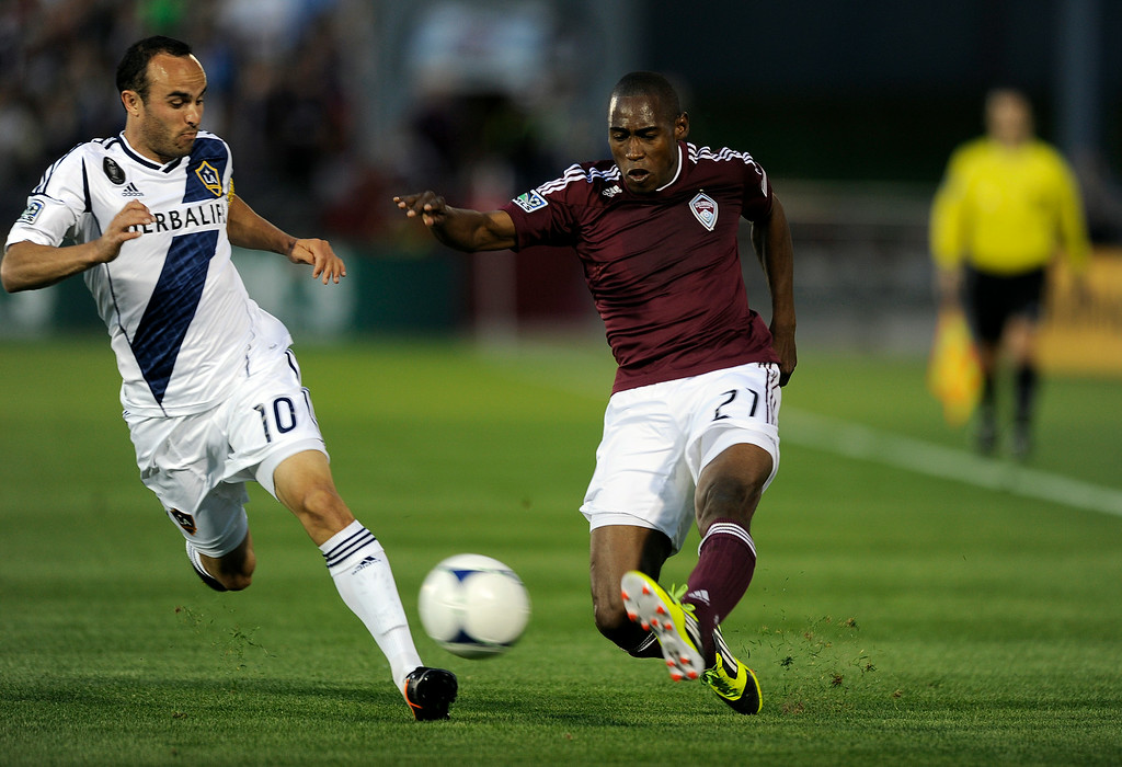 . From left, Los Angeles Galaxy midfielder Landon Donovan (10) and Colorado Rapids defenseman Luis Zapata (21) go after the ball during the first half of an MLS game between the Colorado Rapids and the Los Angeles Galaxy on Saturday, April 21, 2012, at Dick\'s Sporting Goods Park in Commerce City. (Daniel Petty, The Denver Post)