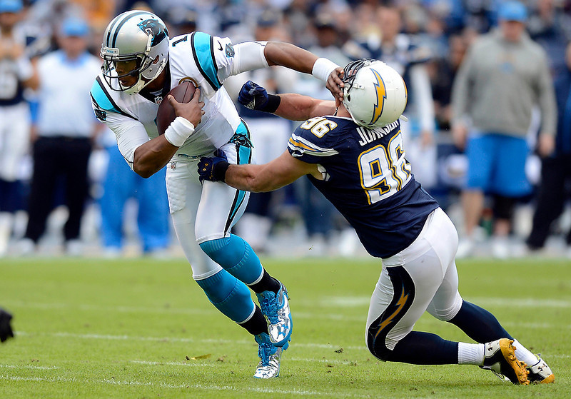 . Carolina Panthers\' Cam Newton (1) fends off San Diego Chargers\' Jarret Johnson (96) in the first half at Qualcomm Stadium on Sunday, December 16, 2012, in San Diego, California. (David T. Foster III/Charlotte Observer/MCT)