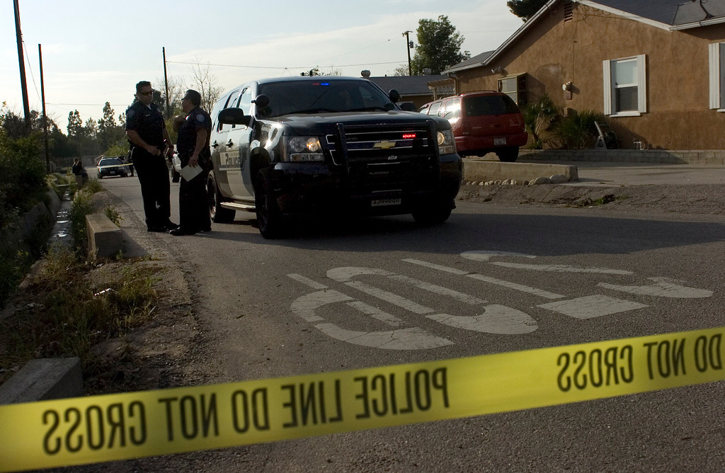 . San Bernardino Police officials investigate the scene of a shooting in the 3300 block of east Love Lane in San Bernardino, CA, Wednesday, March 5, 2014. (Photo by Jennifer Cappuccio Maher/Inland Valley Daily Bulletin)