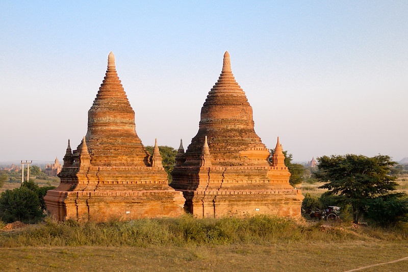 Twin stupas take in a tangerine tinted sunset in Bagan, Burma (Myanmar)