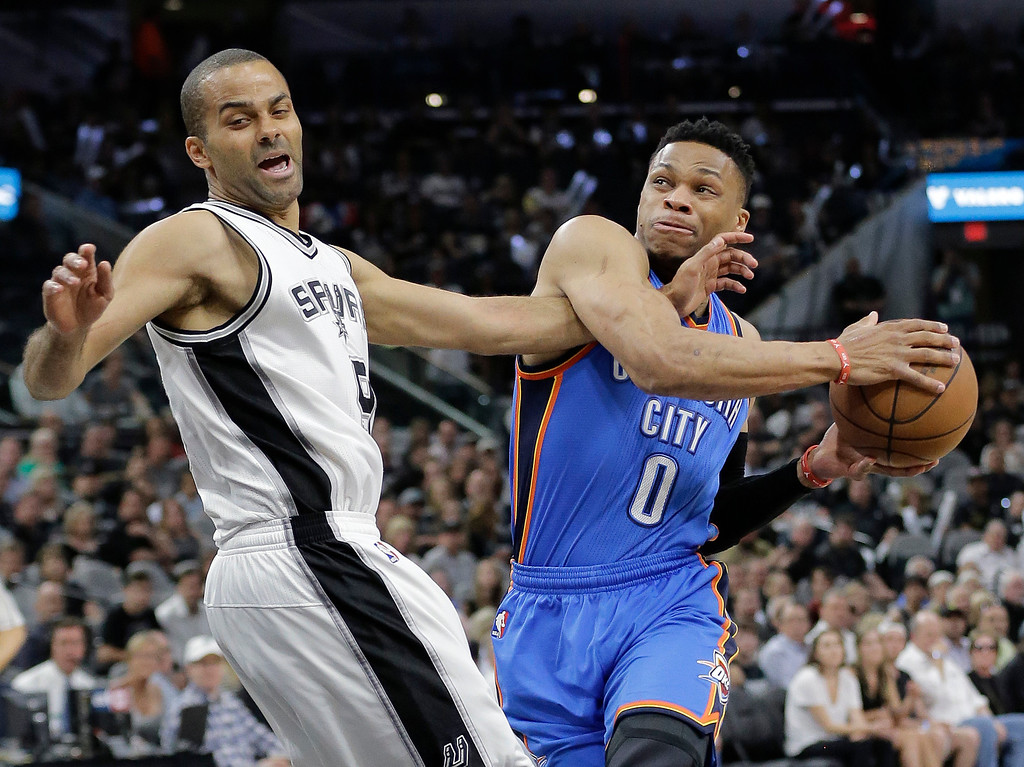 . Oklahoma City Thunder guard Russell Westbrook (0) drives to the basket against San Antonio Spurs guard Tony Parker (9) during the first half in Game 5 of a second-round NBA basketball playoff series, Tuesday, May 10, 2016, in San Antonio. (AP Photo/Eric Gay)