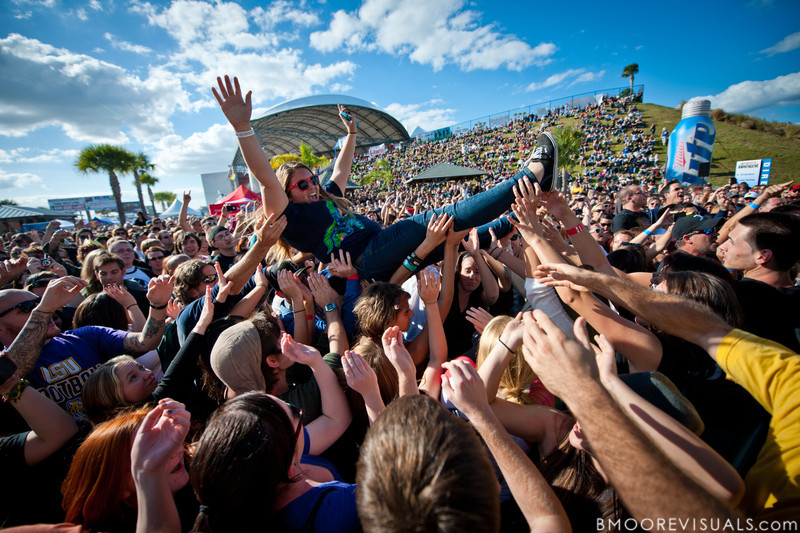 A fan crowd surfs while AWOLNATION performs on December 3, 2011 during 97X Next Big Thing at 1-800-ASK-GARY Amphitheatre in Tampa, Florida