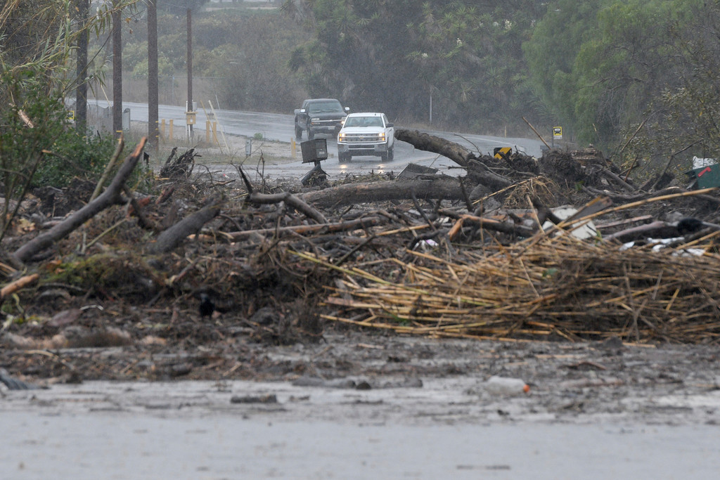 . Debris from a swollen creek blocks Via Real in Carpinteria, Calif., Tuesday, Jan. 9, 2018. (AP Photo/Michael Owen Baker)