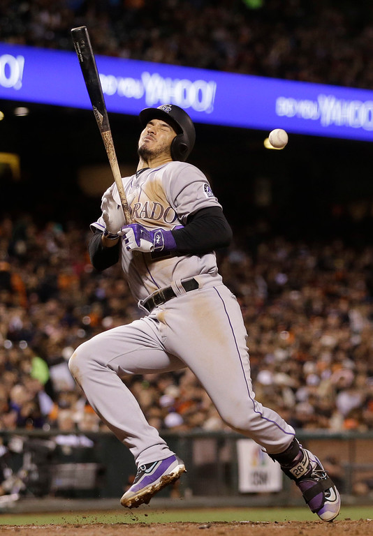 . Colorado Rockies\' Nolan Arenado is hit by a pitch from San Francisco Giants relief pitcher Vin Mazzaro during the fifth inning of a baseball game Thursday, May 5, 2016, in San Francisco. (AP Photo/Marcio Jose Sanchez)