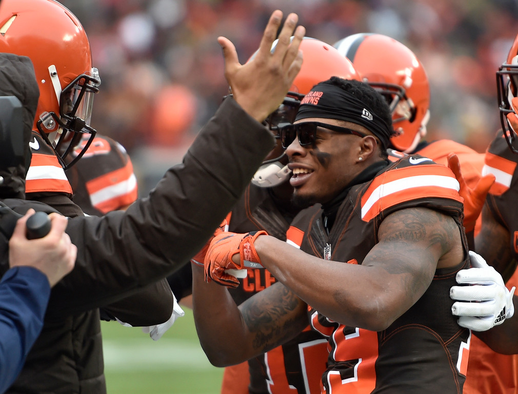 . Cleveland Browns wide receiver Corey Coleman, right, celebrates after scoring on a 2-yard touchdown pass in the second half of an NFL football game against the Green Bay Packers, Sunday, Dec. 10, 2017, in Cleveland. (AP Photo/David Richard)