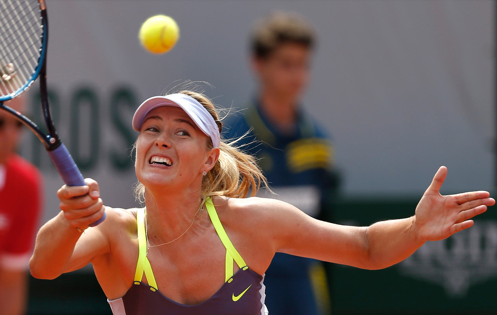 . Russia\'s Maria Sharapova returns the ball to Serena Williams, of the U.S, during the Women\'s final match of the French Open tennis tournament at the Roland Garros stadium Saturday, June 8, 2013 in Paris. (AP Photo/Petr David Josek)