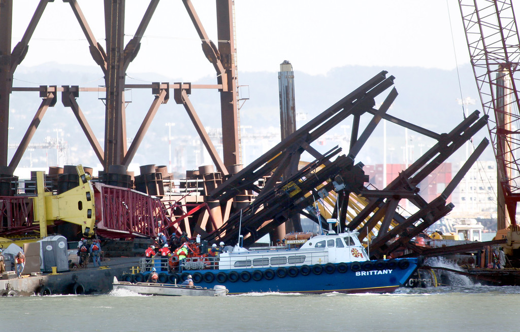 . A large piece of iron falsework juts up at a 45 degree angle next to a crumpled crane boom being used to remove the hardware from the new Bay Bridge project  near Treasure Island on Thursday, Feb. 21, 2013 in San Francisco. (Karl Mondon/Staff)