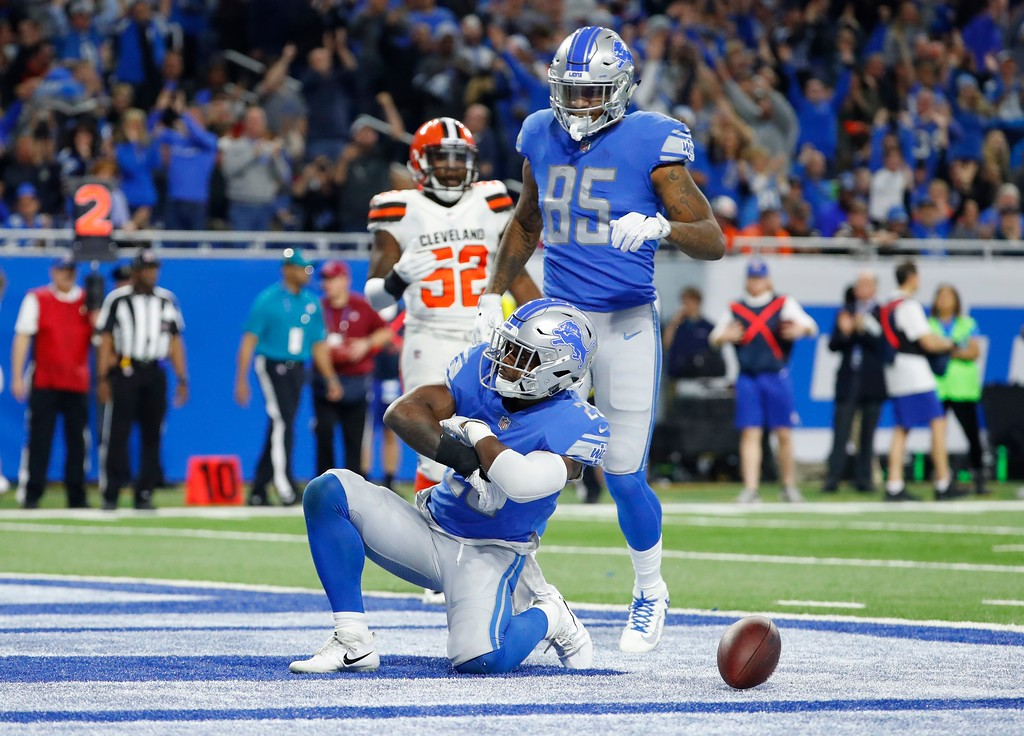 . Detroit Lions running back Theo Riddick reacts after a touchdown during the second half of an NFL football game against the Cleveland Browns, Sunday, Nov. 12, 2017, in Detroit. (AP Photo/Rick Osentoski)