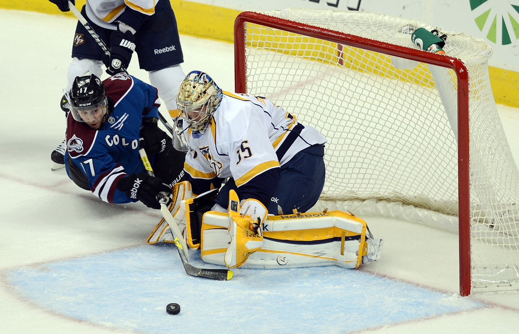 . Pekka Rinne, goalie of Nashville Predators, (#35), right, saves the goal by Colorado Avalanche Aaron Palushaj (#17) in the 2nd period of the game at Pepsi Center. Denver, Colorado. March 30, 2013. (Photo By Hyoung Chang/The Denver Post)