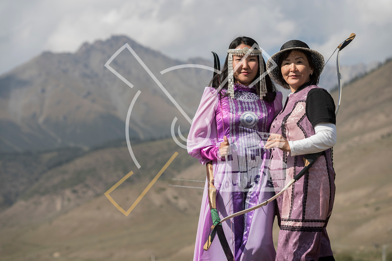 Two women archers from Yakutia dressed up in their traditional archering outfit