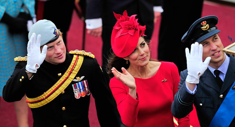 . Britain\'s Catherine, Duchess of Cambridge, (C) Prince William (R) and Prince Harry (L) wave as they pass the Houses of Parliament aboard the Royal barge, \'Spirit of Chartwell\' in central London, on June 3, 2012, during the Thames Diamond Jubilee Pageant. Hundreds of rowing boats, barges and steamers filled the River Thames with a blaze of colour on Sunday as Queen Elizabeth II sailed through London as part of her spectacular diamond jubilee pageant.   AFP PHOTO / GLYN  KIRK/AFP/Getty Images
