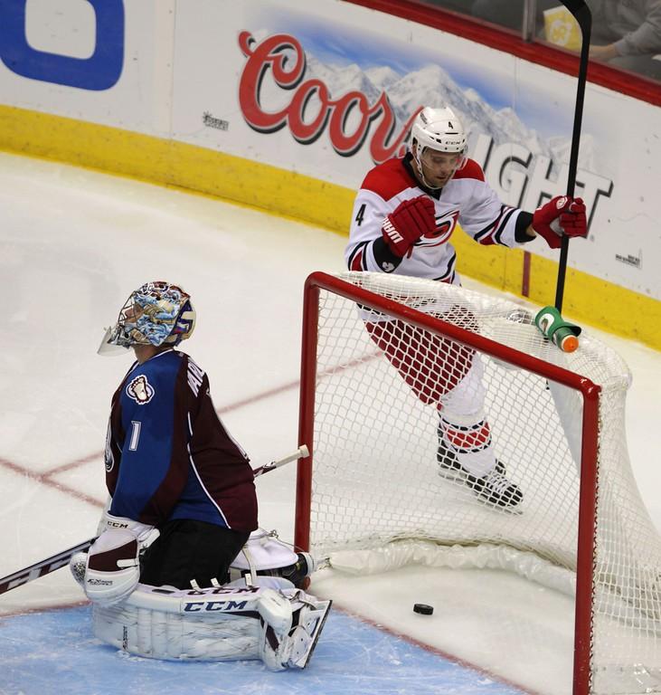 . Carolina Hurricanes defenseman Andrej Sekera (4), of Slovakia, celebrates his goal as Colorado Avalanche goalie Semyon Varlamov (1) kneels in the crease  in the third period of a hockey game in Denver on Friday, Oct. 25, 2013. Colorado won 4-2. (AP Photo/Joe Mahoney)