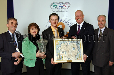 Donal Kane a past pupil of Abbey Christian Brothers Grammar School accepts the Tim McCall History Award from Gavin Boyd, CCEA Chief Executive for his fantastic achievement of overall first place in History in CCEA's summer 2006 A level examinations.  Also pictured are Donal's parents, Mr and Mrs Kane and Principal Mr McGovern.