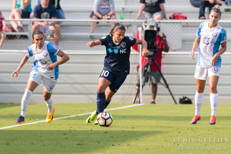 Debinha (10) and Marta (10) during a match between the NC Courage and the Orlando Pride in Cary, NC in Week 3 of the 2017 NWSL season. Photo by Lewis Gettier.