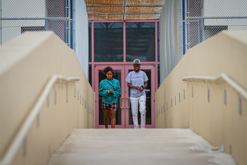 Kenria Woodson of Belle Glade, left, and Tray Johns of the New Florida Majority, walk across the skyway from the Palm Beach County Jail on Gun Club Road in West Palm Beach, Sunday, May 10, 2020. Johns' organization raised the money to bail Woodson out of jail for Mother's Day. [JOSEPH FORZANO/palmbeachpost.com]