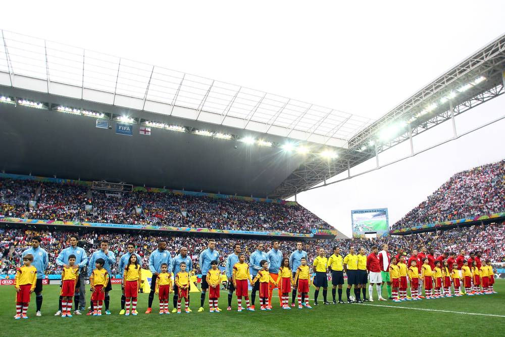 . Players line up on the field before the 2014 FIFA World Cup Brazil Group D match between Uruguay and England at Arena de Sao Paulo on June 19, 2014 in Sao Paulo, Brazil.  (Photo by Julian Finney/Getty Images)