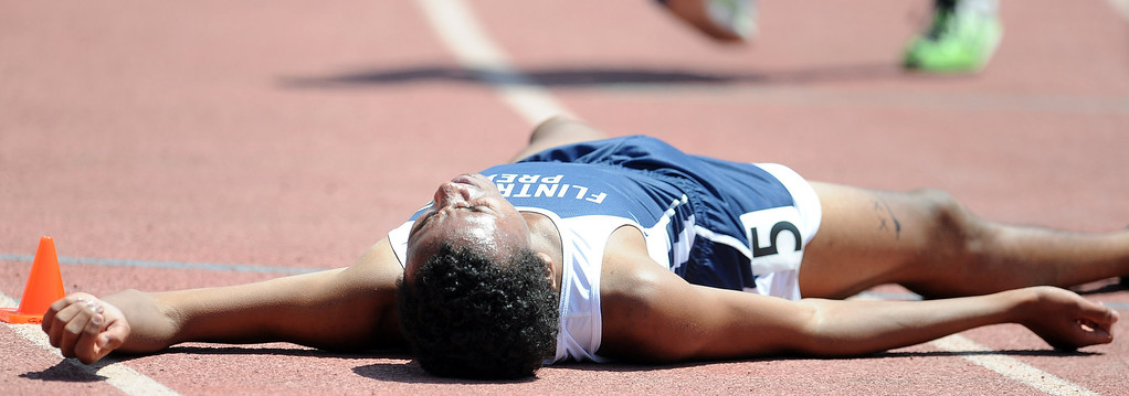 . Flintrtidge Prep\'s Alan Yoho collapses after finishing second in the 1600 meter race during the CIF-SS track & Field championship finals in Hilmer Stadium on the campus of Mt. San Antonio College on Saturday, May 18, 2013 in Walnut, Calif.  (Keith Birmingham Pasadena Star-News)