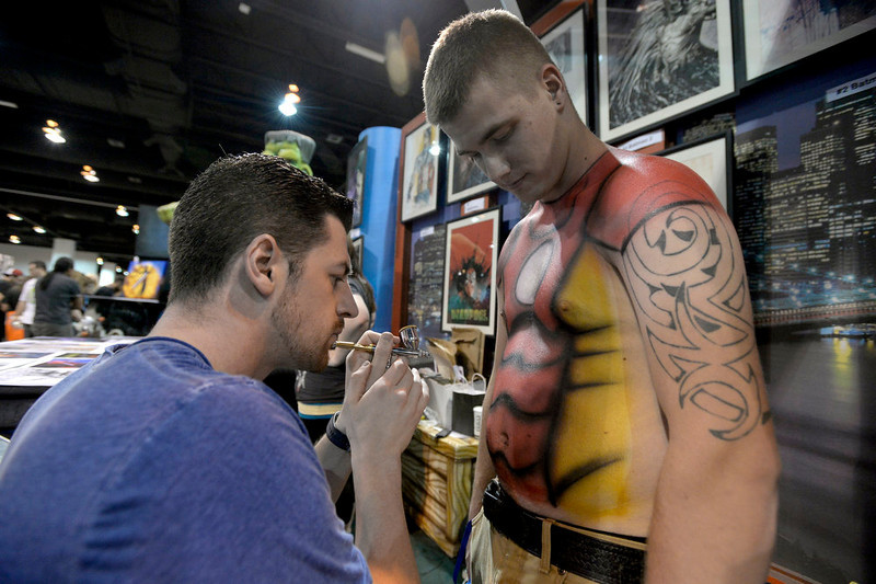 . Clayton King 22-years-old gets painted by David Brawner of Little Spider Creations using an air brush to do is work. More than 45,000 flooded the convention floor for the Denver Comic Con June 2, 2013 at the Colorado Convention Center. The convention ended its three day marathon with an appearance by William Shatner. (Photo By John Leyba/The Denver Post)