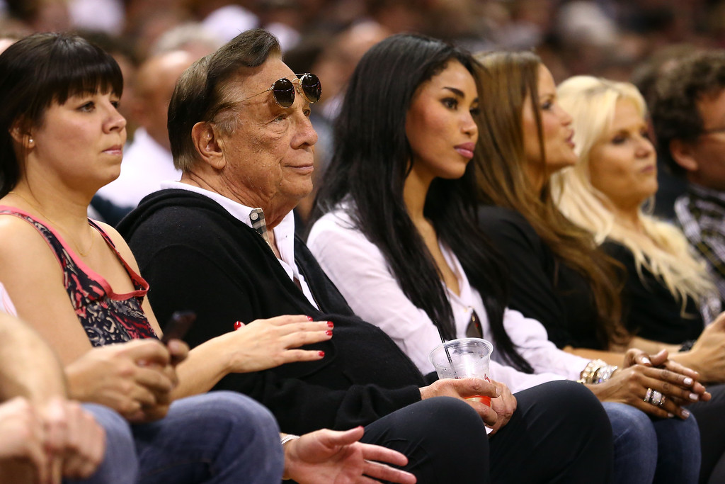 . SAN ANTONIO, TX - MAY 19:  (2nd L) Team owner Donald Sterling of the Los Angeles Clippers watches the San Antonio Spurs play against the Memphis Grizzlies during Game One of the Western Conference Finals of the 2013 NBA Playoffs at AT&T Center on May 19, 2013 in San Antonio, Texas.   (Photo by Ronald Martinez/Getty Images)