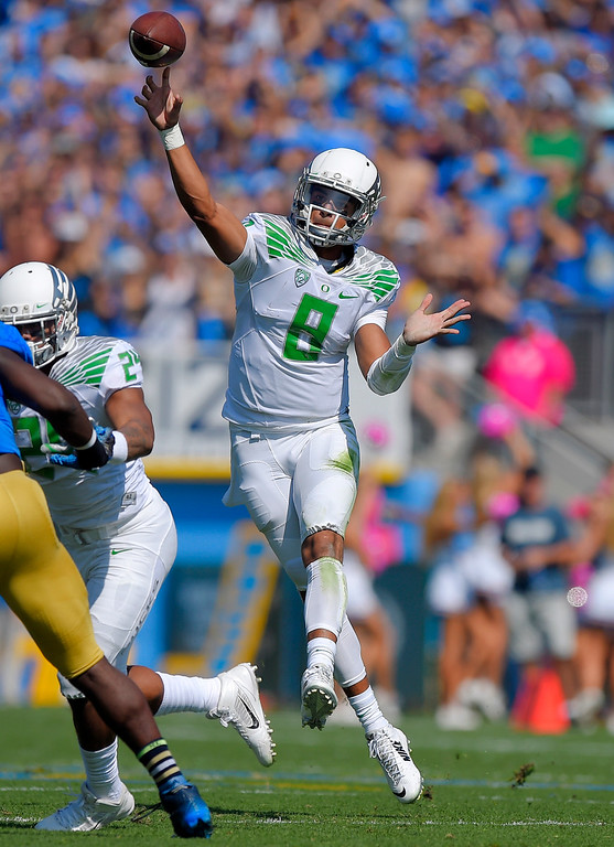 . In this Oct. 11, 2014, file photo, Oregon quarterback Marcus Mariota passes during the first half of an NCAA college football game against UCLA in Pasadena, Calif. (AP Photo/Mark J. Terrill, File)