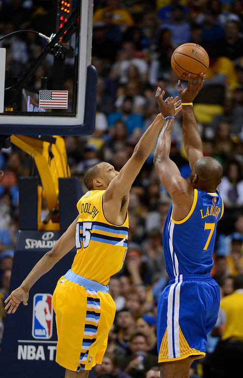 . DENVER, CO. - APRIL 20: Golden State Warriors power forward Carl Landry (7) takes a shot over Denver Nuggets power forward Anthony Randolph (15) in the second quarter. The Denver Nuggets took on the Golden State Warriors in Game 1 of the Western Conference First Round Series at the Pepsi Center in Denver, Colo. on April 20, 2013. (Photo by John Leyba/The Denver Post)