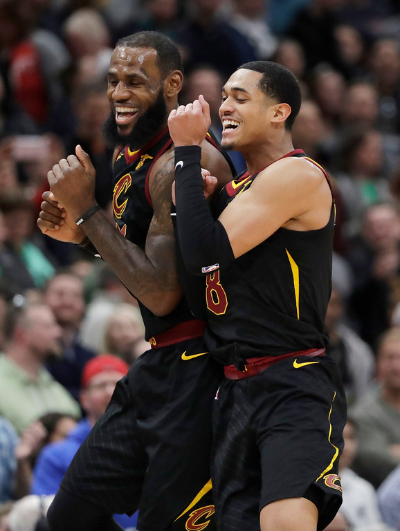 . Cleveland Cavaliers forward LeBron James, left, smiles as he celebrates with guard Jordan Clarkson after scoring a basket against the Chicago Bulls during the second half of an NBA basketball game Saturday, March 17, 2018, in Chicago. The Cavaliers won114-109. (AP Photo/Nam Y. Huh)