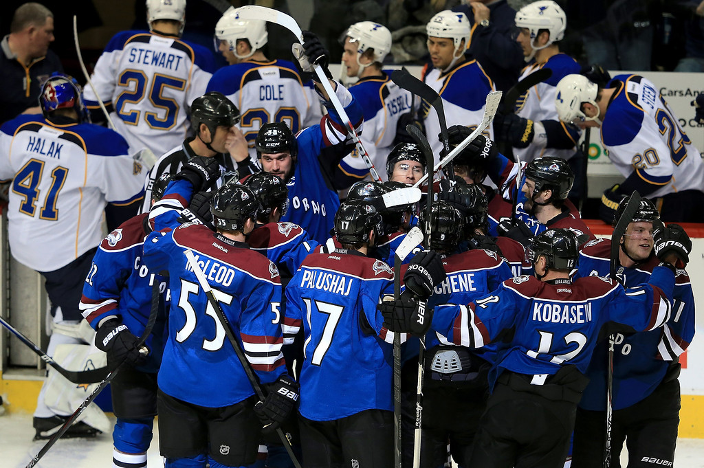 . David Jones (C) #54 of the Colorado Avalanche is swarmed by his teammates after scoring the game winning goal in overtime against Jaroslav Halak #41 of the St. Louis Blues at the Pepsi Center on February 20, 2013 in Denver, Colorado. The Avalanche defeated the Blues 1-0 in overtime.  (Photo by Doug Pensinger/Getty Images)