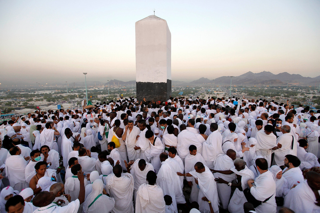 . Muslim pilgrims pray on a rocky hill called the Mountain of Mercy, near the holy city of Mecca, Saudi Arabia, Monday, Oct. 14, 2013. (AP Photo/Amr Nabil)