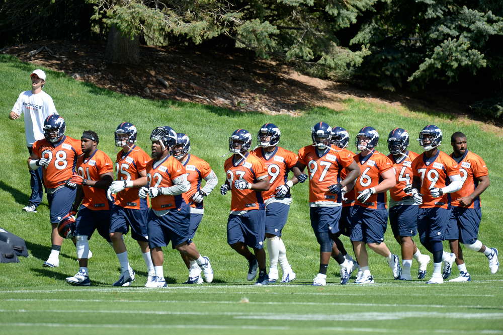 . The Denver Broncos defensive line heads to their next station during the teams OTAs May 20, 2013 at Dove Valley. All offseason training activities (OTAs) are voluntary until the mandatory minicamp June 11-13. (Photo By John Leyba/The Denver Post)