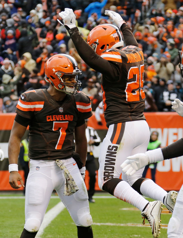 . Cleveland Browns running back Duke Johnson, right, celebrates with quarterback DeShone Kizer, left, after scoring a touchdown after a 27-yard pass in the first half of an NFL football game against the Jacksonville Jaguars, Sunday, Nov. 19, 2017, in Cleveland. (AP Photo/Ron Schwane)