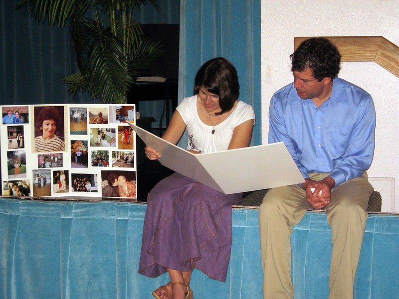 Abby and Avram (Bernice's granddaughter and her husband) look at photos of Bernice