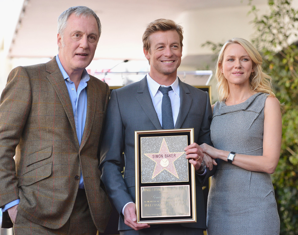 . Executive producer Bruno Heller, actress Robin Tunney and actor Simon Baker attend a ceremony honoring Simon Baker with the 2,490th Star on The Hollywood Walk of Fame on February 14, 2013 in Hollywood, California.  (Photo by Alberto E. Rodriguez/Getty Images)