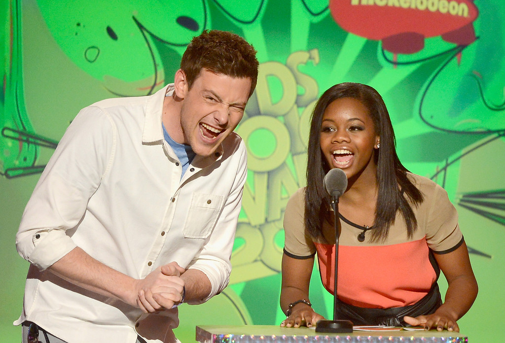 . LOS ANGELES, CA - MARCH 23:  Actor Cory Monteith and Olympic gymnast Gabby Douglas speak onstage during Nickelodeon\'s 26th Annual Kids\' Choice Awards at USC Galen Center on March 23, 2013 in Los Angeles, California.  (Photo by Kevork Djansezian/Getty Images for KCA)