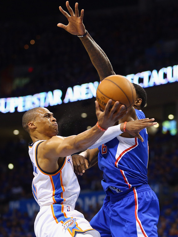 . Russell Westbrook #0 of the Oklahoma City Thunder takes a shot against DeAndre Jordan #6 of the Los Angeles Clippers in Game One of the Western Conference Semifinals during the 2014 NBA Playoffs at Chesapeake Energy Arena on May 5, 2014 in Oklahoma City, Oklahoma.   (Photo by Ronald Martinez/Getty Images)