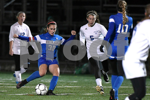 11/14/2017 Mike Orazzi | Staff St. Paul's Briana Senese (38) scores against Old Lyme during the Class S Semifinals Girls Soccer at Falcon Field in Meriden Tuesday night.