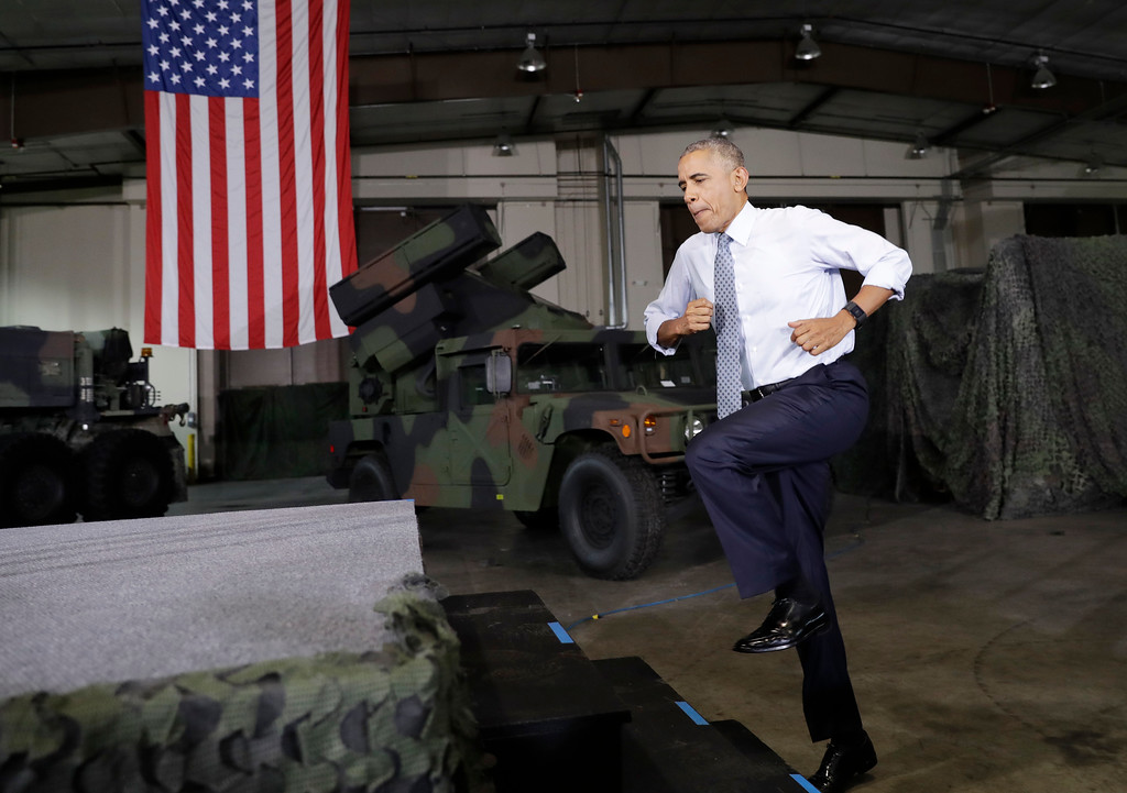 . President Barack Obama jumps up the stairs to take the stage to speak to members of the military community, Wednesday, Sept. 28, 2016, in Fort Lee, Va. (AP Photo/Carolyn Kaster)