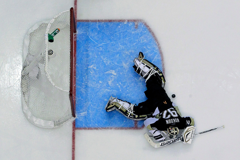 . Pittsburgh Penguins goalie Tomas Vokoun (92) lies in the goal crease after allowing a goal by Boston Bruins\' Nathan Horton in the third period of Game 1 of the NHL hockey Stanley Cup Eastern Conference finals in Pittsburgh, Saturday, June 1, 2013. The Bruins won 3-0. (AP Photo/Gene J. Puskar)