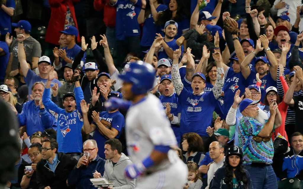. Toronto Blue Jays fans cheer as Edwin Encarnacion rounds the bases after he hit a two-run home run in the third inning of a baseball game against the Seattle Mariners, Monday, Sept. 19, 2016, in Seattle. (AP Photo/Ted S. Warren)