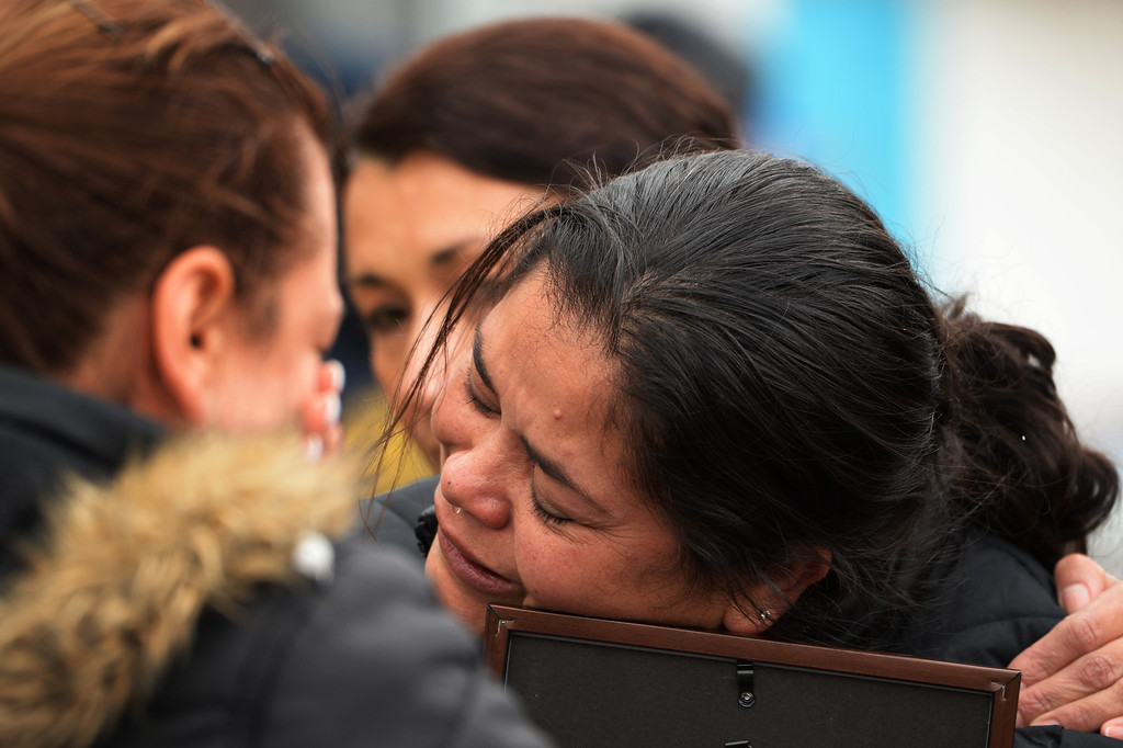 . Blanca Palomino hugs a photo of her son, Juan Carlos Dominguez-Palomino, who was killed earlier in a fatal crash, Monday, March 24, 2014. (Photo by RJ Sangosti/The Denver Post)
