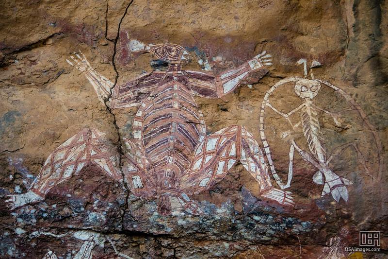 "Namarndiolg/Ginga (L) and ""Namarrgon the Lightning Man"" (R) Aboriginal rock art at the Anabangbang Gallery"