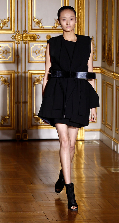 . A model wears a creation during Rad Hourani\'s Spring-Summer 2014 Haute Couture fashion collection presented in Paris, Wednesday, Jan.22, 2014. (AP Photo/Remy de la Mauviniere)