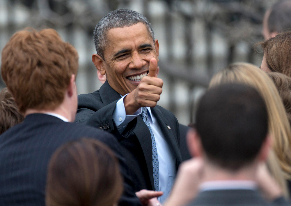. President Barack Obama give the thumbs up as he greets people during a ceremony on the South Lawn of the White House in Washington, Tuesday, April 1, 2014, to honor the 2013 World Series baseball champion Boston Red Sox.  (AP Photo/Carolyn Kaster)