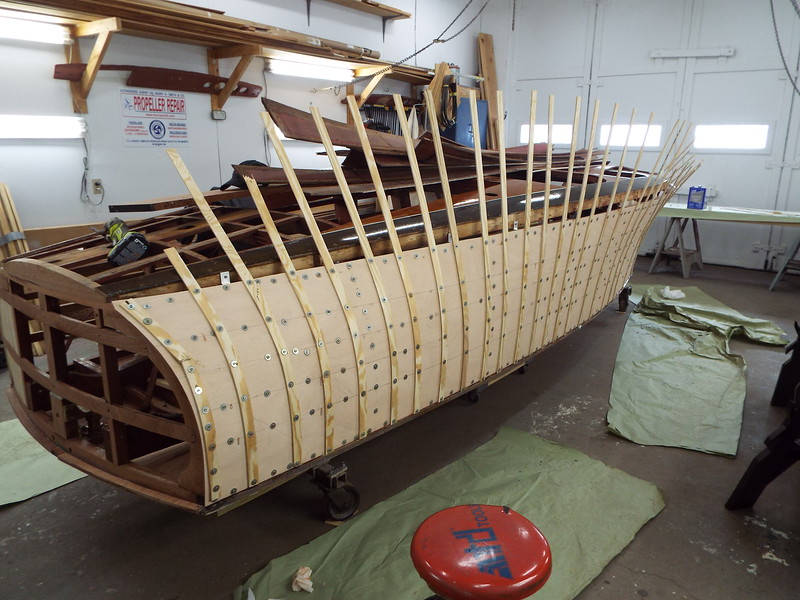 Rear starboard view of the plywood skin epoxied in place. Temporary fasteners to be removed tomorrow.