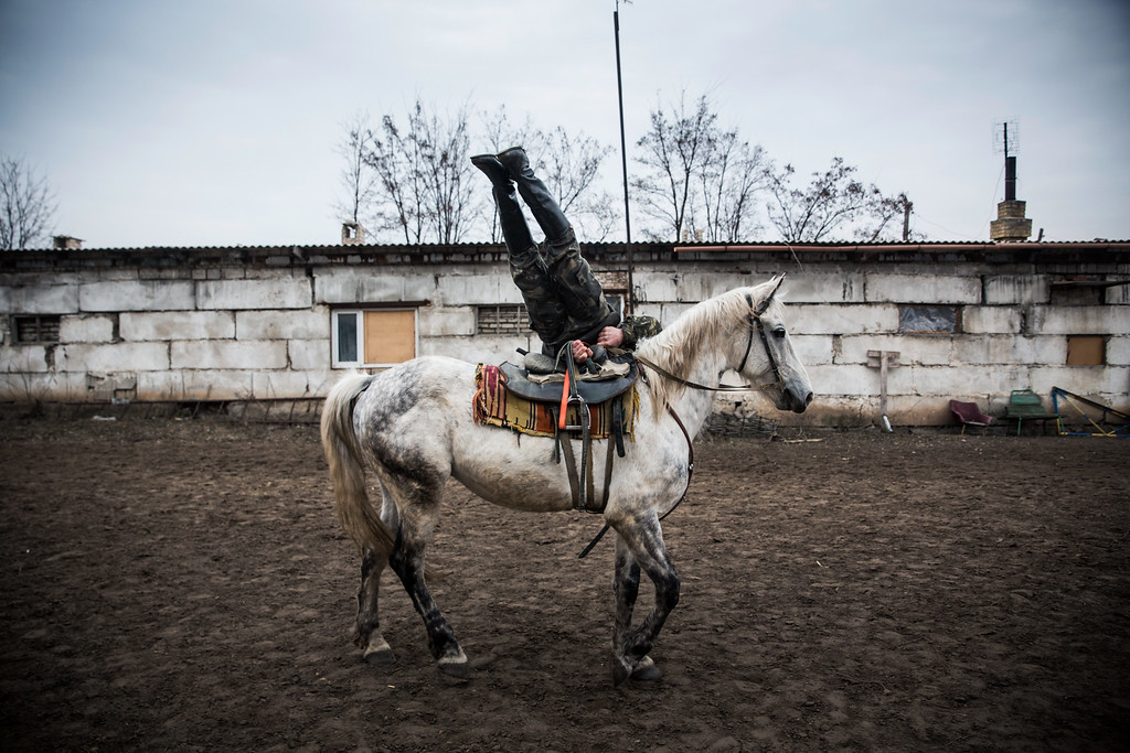 . An ethnically Cossack pro-Russian rebel displays his horsemanship during a skills performance on March 12, 2015 in Makeevka, Ukraine. The conflict between Ukraine and pro-Russian rebels, which has gone on for almost a year, has left over 6,000 people dead, according to the United Nations.  (Photo by Andrew Burton/Getty Images)