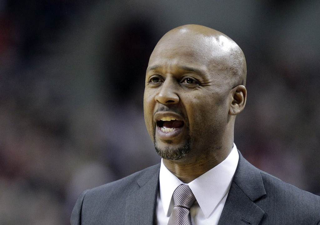 . Denver Nuggets coach Brian Shaw calls out from the bench during the first half of an NBA basketball game against the Portland Trail Blazers in Portland, Ore., Saturday, March 1, 2014. (AP Photo/Don Ryan)